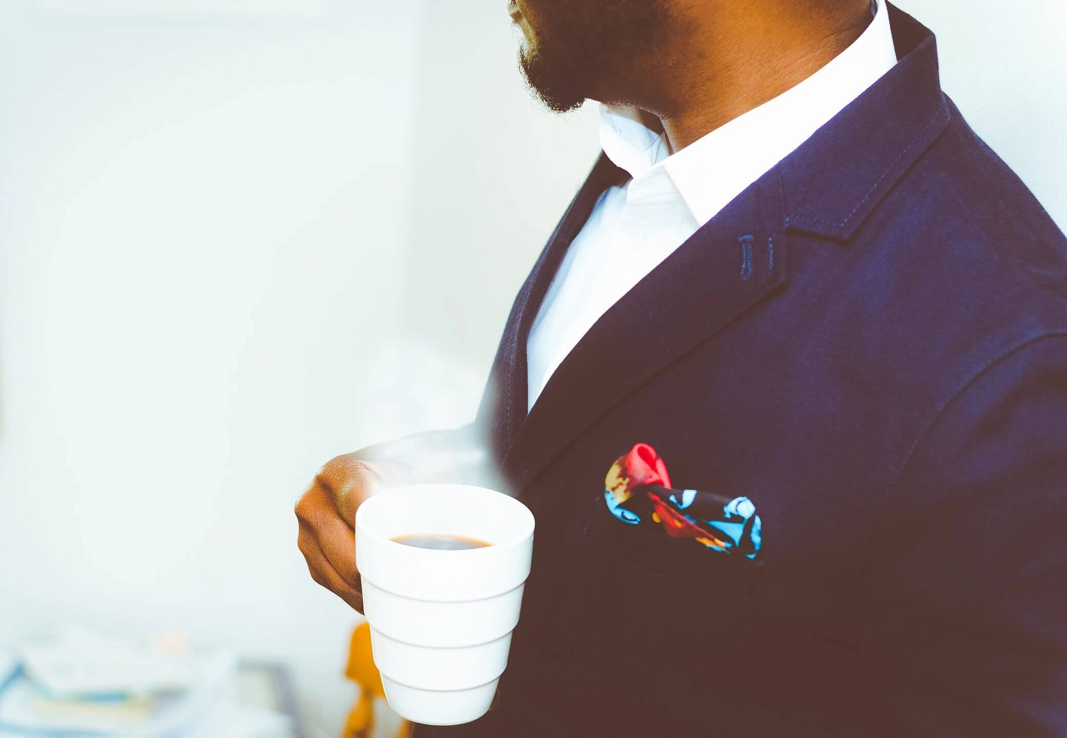 Business man drinking coffee, preparing for the work day